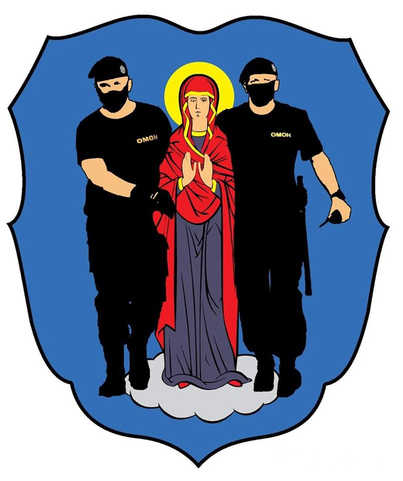 "An emblemic shield which shows on a blue background a Madonna escorted by two white men dressed in all black. The logo on their shirt reads ""OMON"" (a Belarusian law enforcement force, whose squads participate in the supression of the protests in Belarus and are said to have committed multiple human rights violations)"